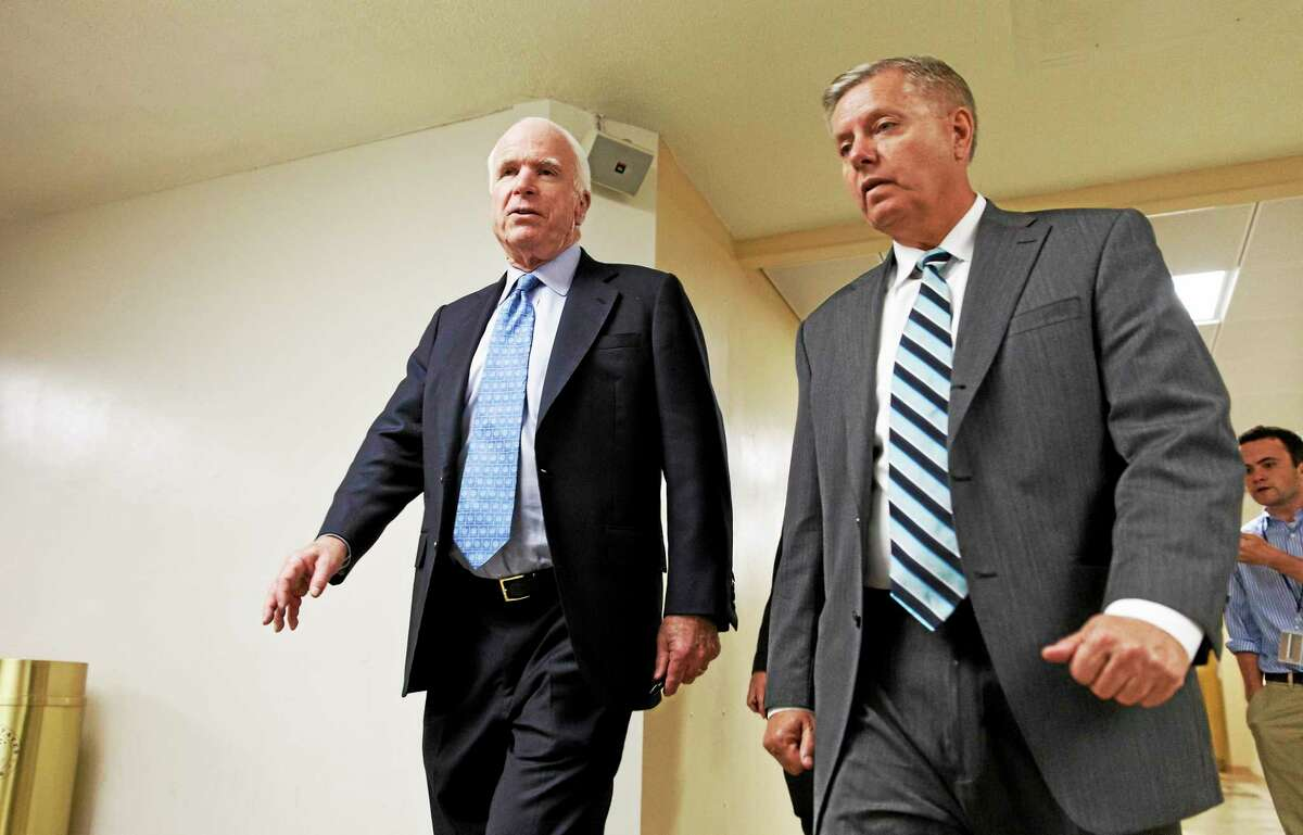 Sen. John McCain, R-Ariz., left, and Sen. Lindsey Graham, R-S.C., right, both members of the Senate Armed Services Committee. Sen. McCain and three other GOP senators introduced a bill that would give veterans more flexibility to see a private doctor if they are forced to wait too long for an appointment at a Veterans Affairs hospital or clinic.