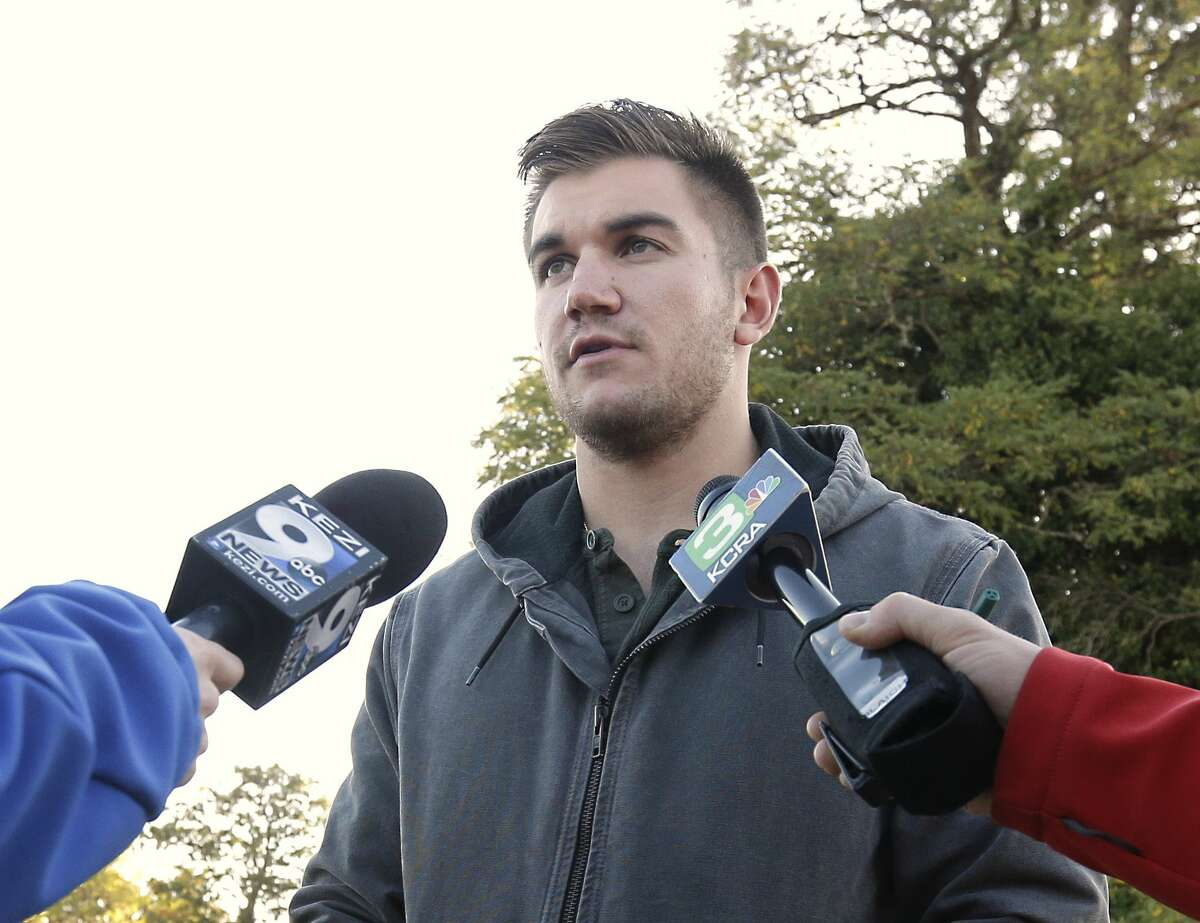 """Alek Skarlatos, one of the three Americans who stopped a terrorist attack aboard a Paris-bound train in August, talks to reporters about the shooting at Umpqua Community College, Friday, Oct. 2, 2015, in Roseburg, Ore. Skarlatos said he would have been attending a class at the college when a gunman killed people Thursday if he had not been in Los Angeles to rehearse for ABC's """"Dancing With the Stars."""""""