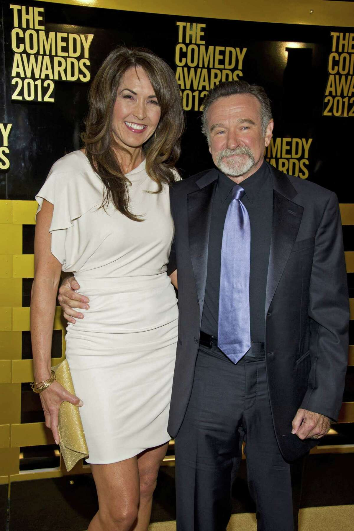 FILE - In this April 28, 2012, file photo Robin Williams, right, and his wife, Susan Schneider arrive to the 2012 Comedy Awards in New York. Attorneys for Robin Williams' widow and his children have reached a settlement in their legal fight over his estate.