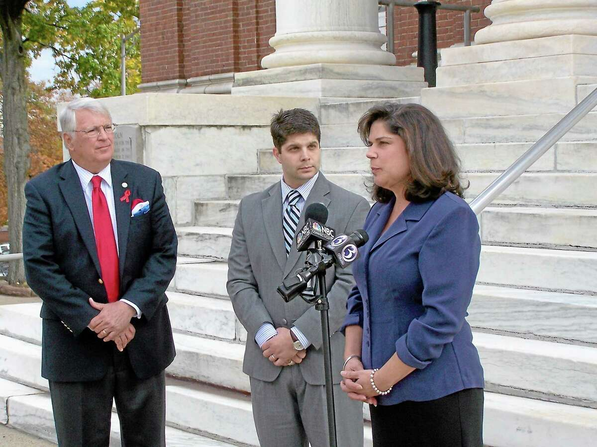 Meriden Mayor Michael Rohde, Middletown Mayor Dan Drew and state Sen. Dante Bartolomeo hold a press conference outside of Meriden City Hall in this file photo.