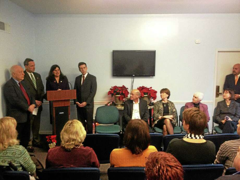 From left, at podium: State Rep. Joseph Serra, sens. Paul Doyle and Dante Bartolomeo and Rep. Matthew Lesser gather to discuss homelessness amid the closing of the Shepherd Home and the expansion of the Eddy Shelter at Connecticut Valley Hospital in Middletown in this file photo. Photo: Alex Gecan - The Middletown Press