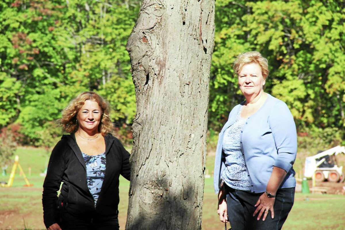 As the Connecticut Trees of Honor Memorial project nears completion of phase one construction, additional volunteers are needed to help rake and spread mulch around the 65 trees planted at Veterans Memorial Park. Shown are project organizers Sue Martucci and Gold Star Mother Diane DeLuzio.