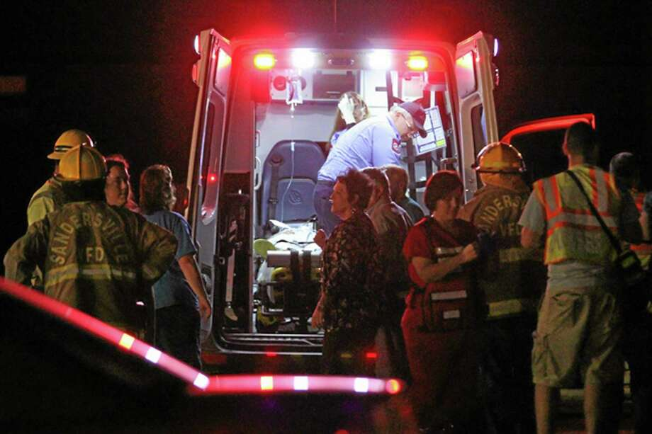 Emergency responders, members of Freedom Baptist Church, and Myrick community members in rural Jones County, Miss. gather near an ambulance outside the Freedom Baptist Church Wednesday night after a second floor youth room collapsed onto a first floor kitchen. Up to 35 youth ages from seventh grade to 12th grade were injured. A 16-year-old girl who suffered a head injury was airlifted to Forrest General Hospital in Hattiesburg. AP Photo/The Chronicle, James Pugh Photo: AP / James Pugh / The Chronicle