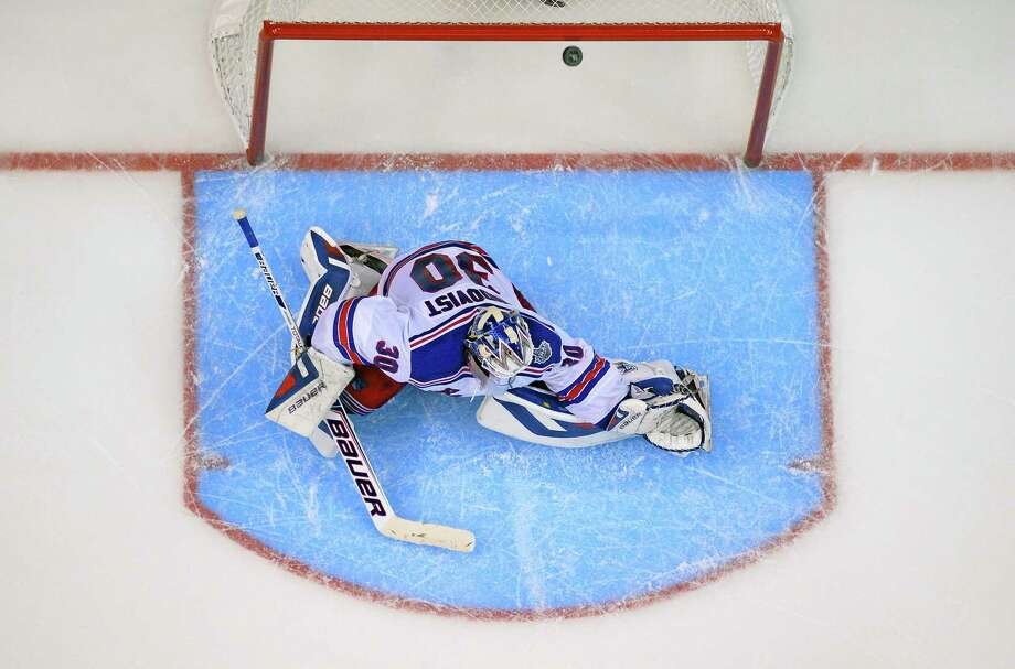 Rangers goalie Henrik Lundqvist is scored on by Los Angeles Kings right wing Dustin Brown during the second overtime period in Game 2 on Saturday. The Kings won 5-4. Photo: Mark J. Terrill — The Associated Press  / AP