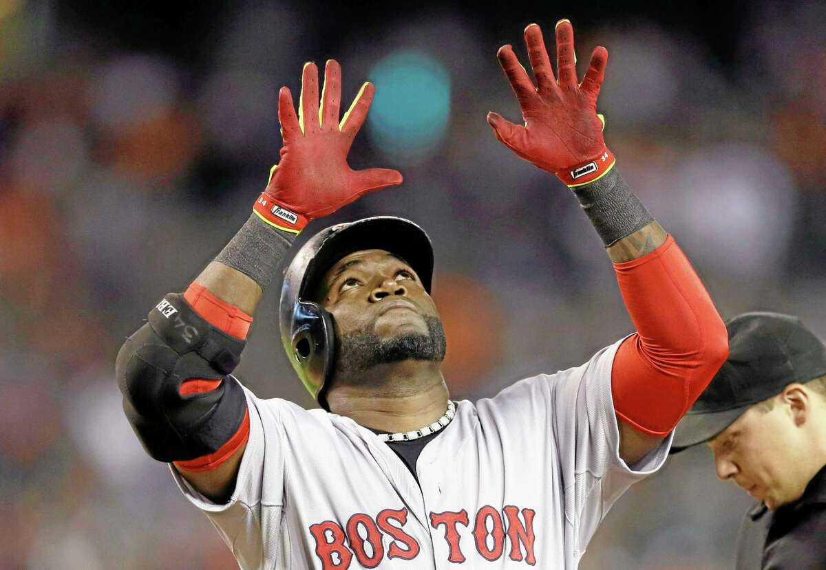 Red Sox designated hitter David Ortiz looks up as he crosses home plate after his three-run home run in the ninth inning Sunday.