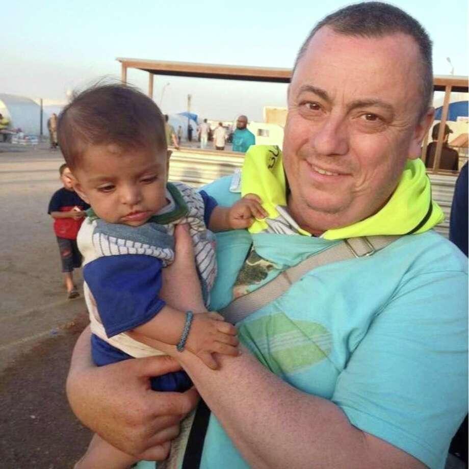 This undated family handout photo shows British man Alan Henning, who was held hostage by the Islamic State group. An Internet video released Friday purports to show an Islamic State group fighter beheading British hostage Alan Henning and threatening yet another American captive, the fourth such killing carried out by the extremist group now targeted in U.S.-led airstrikes. The video mirrored other beheading videos shot by the Islamic State group, which now holds territory along the border of Syria and Iraq. It ended with an Islamic State fighter threatening a man they identified as an American. Photo: (The Associated Press) / family handout