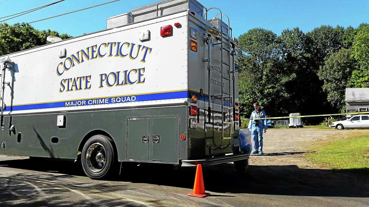 State police are shown investigating an assault on White Birch Road in East Hampton Sept. 17, 2014, in this file photo.