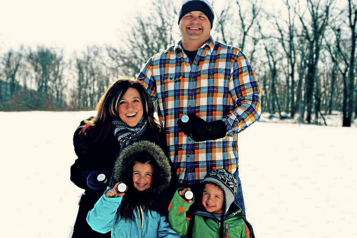 Clockwise from top left are Lip Luxe founder Brenda Mierzejewski of Portland, her husband David Mierzejewski, assistant principal at Woodrow Wilson Middle School in Middletown; and children Brady, 4, and Leana, 6.