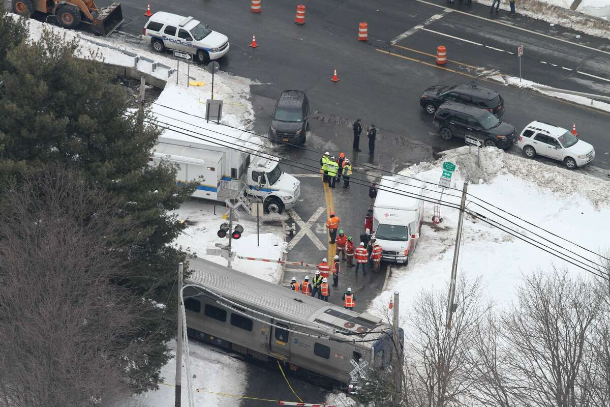Personnel from various agencies work the scene of a deadly commuter train accident in Valhalla, N.Y., Wednesday, Feb. 4, 2015. (Frank Becerra Jr. — The Journal-News)