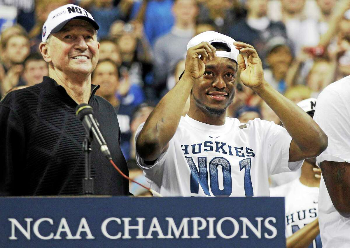 UConn coach Jim Calhoun and guard Kemba Walker share a smile while celebrating the Huskies' 2011 national championship.
