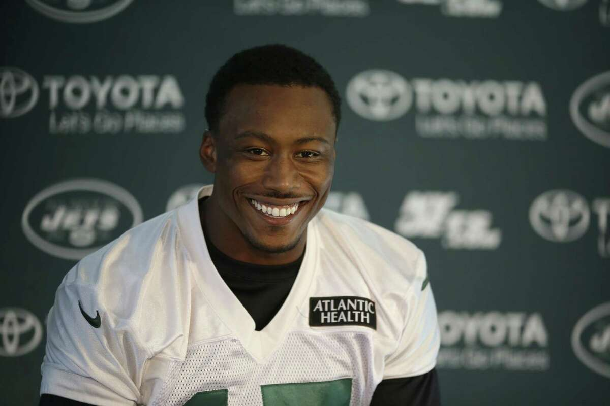 Wide receiver Brandon Marshall smiles during a press conference after an NFL training session at London Irish training ground Friday.
