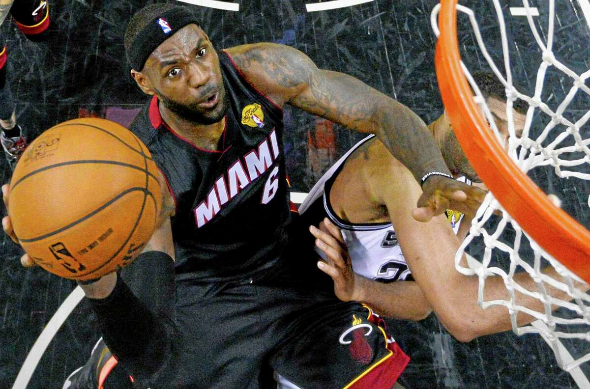 Miami Heat forward LeBron James shoots over Spurs forward Tim Duncan during the first half in Game 2 of the NBA Finals on Saturday in San Antonio.