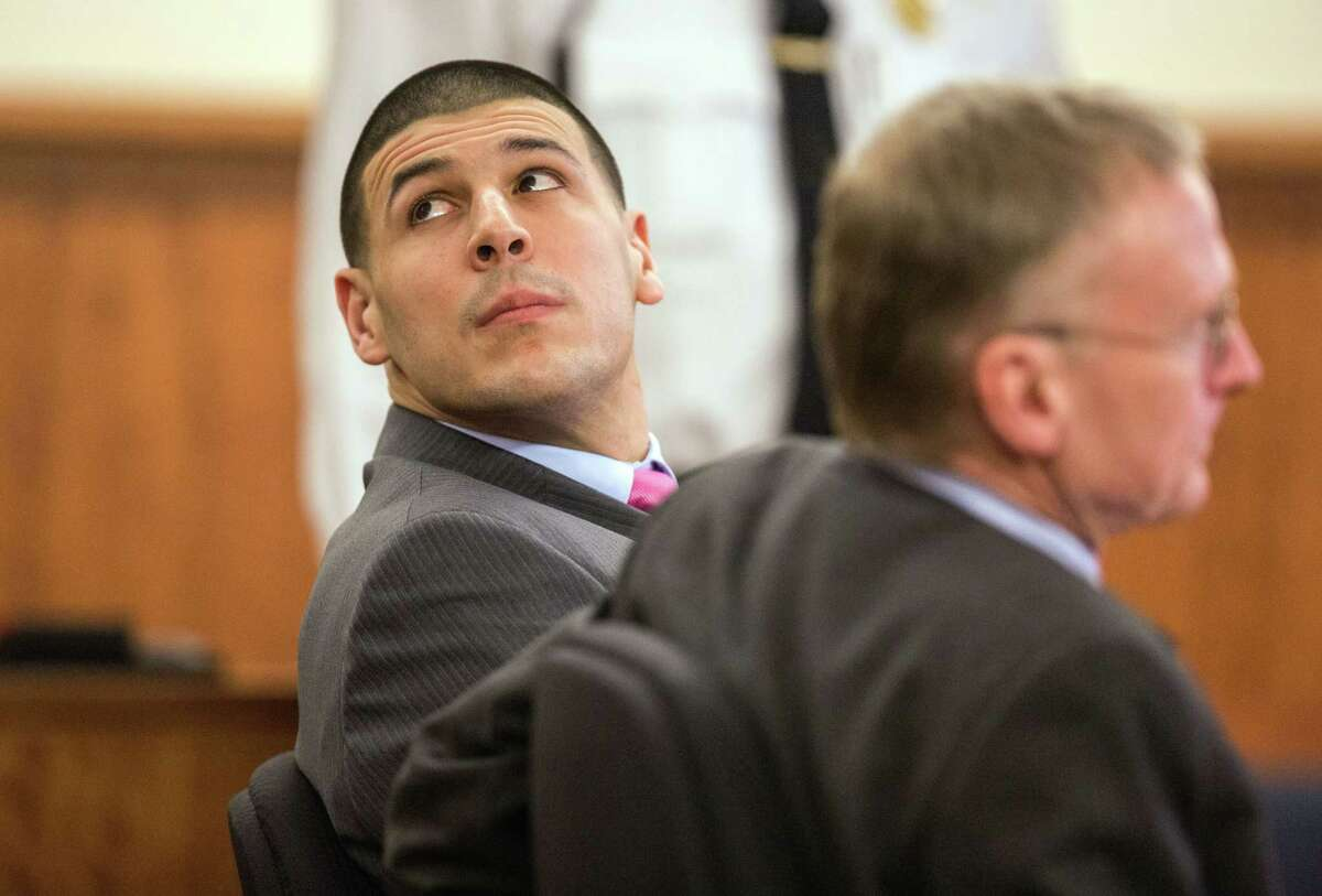 Former New England Patriots player Aaron Hernandez glances toward the clock during his trial Tuesday at Bristol County Superior Court in Fall River, Mass.