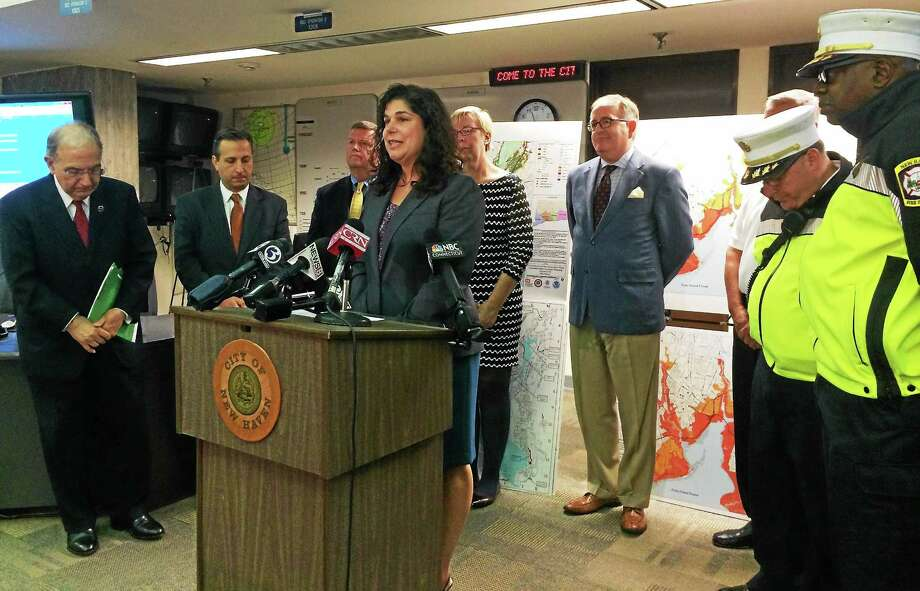 Wes Duplantier -- Middletown Press  State Sen. Dante Bartolomeo, who represents Cheshire, Meriden, Middletown and Middlefield, speaks Thursday at a news conference about the state's price gouging law. Bartolomeo and other lawmakers urged people to report any unfair prices they see following severe weather in the state. Photo: Journal Register Co.