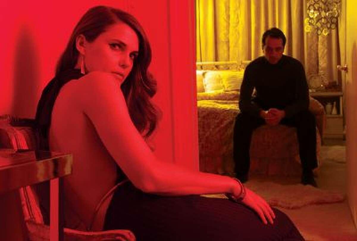 Keri Russell, left, as Elizabeth Jennings, Matthew Rhys as Phillip Jennings in FX's smart espionage drama,