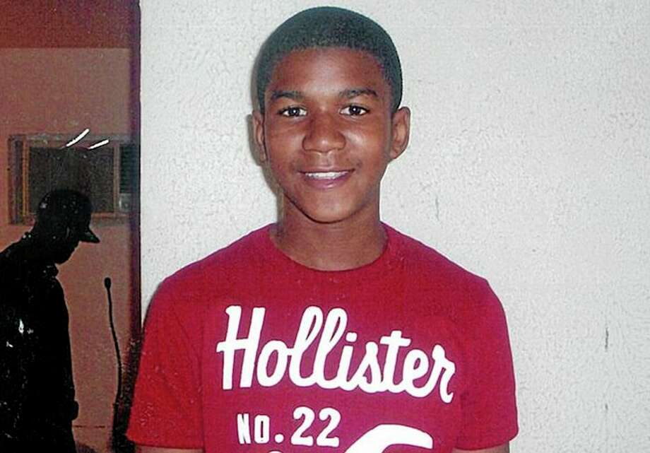 FILE - This undated file family photo shows Trayvon Martin. Trayvon, 17, was slain in a 2012 shooting in Sanford, Fla., by neighborhood crime-watch captain George Zimmerman. The Goodman Theatre is the latest company to join a national initiative staging a night of short plays about the killing of Trayvon Martin. The Goodman will present six 10-minute works by Marcus Gardley, Tala Manassah, Mona Mansour, Winter Miller, Dominique Morisseau, Dan OíBrien, Quetzel Flores and A. Rey Pamatmat as part of a March 3 production of ìFacing Our Truth: Short Plays on Trayvon Martin, Race and Privilege.î (AP Photo/Martin Family, File) Photo: AP / Martin Family