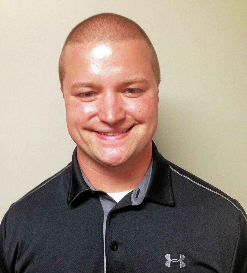 Portland's newest police officer is Micheal Revicki. Photo: Jeff Mill — The Middletown Press