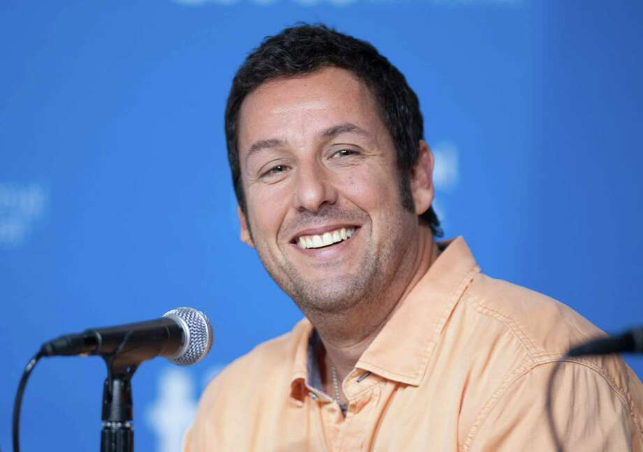 "Actor Adam Sander smiles during a Sept. 6 press conference for ""Men, Women, and Children"" at the 2014 Toronto International Film Festival in Toronto. Sandler has signed a deal with Netflix to star in and produce four films for the streaming service. Photo: Associated Press  / The Canadian Press"