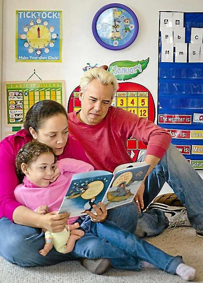 Angelique and Eric Henderson with their daughter Marielle.three. They are home schooling Marielle. Melanie Stengel/Register Photo: Journal Register Co.