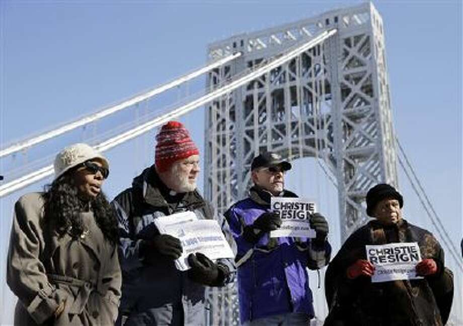 Valerie Howard Fadul, left, who says she was stuck for hours in last September's traffic jams, stands with Dave Stump, second left, Natalee Addison, right, and Frank Puzzeo, second right, as they protest near the George Washington Bridge, Tuesday, Feb. 11, 2014, in Fort Lee, The group included some people who were caught in traffic there last September due to bridge closures that have created a major controversy in Gov. Chris Christie's administration. (AP Photo/Mel Evans) Photo: AP / AP