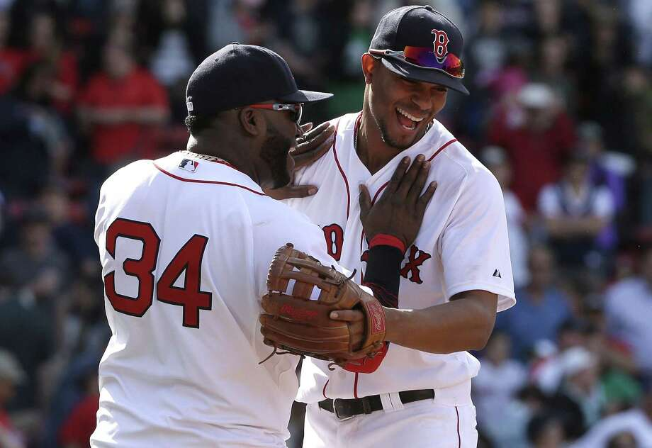 Boston's David Ortiz, left, celebrates with teammate Xander Bogaerts after they defeated the Athletics on Sunday. Photo: Steven Senne — The Associated Press  / AP
