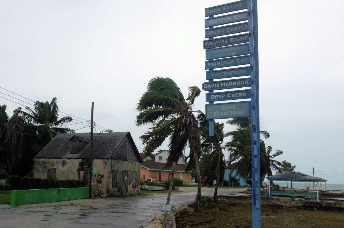 The sky is overcast on south Eleuthera island, Bahamas, early Friday, Oct. 2, 2015 as Hurricane Joaquin dumps torrential rains across the eastern and central Bahamas as a Category 4 storm. Streets were largely deserted as people remained hunkered down on the island of Eleuthera, which was bracing for heavy winds later Friday. (AP Photo/Ben Fox)