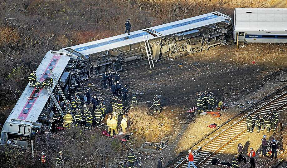 FILE - In this Sunday, Dec. 1, 2013, file photo, first responders work the scene of a derailment of a Metro-North passenger train in the Bronx borough of New York. Photo: (Craig Ruttle — The Associated Press) / FR61802 AP