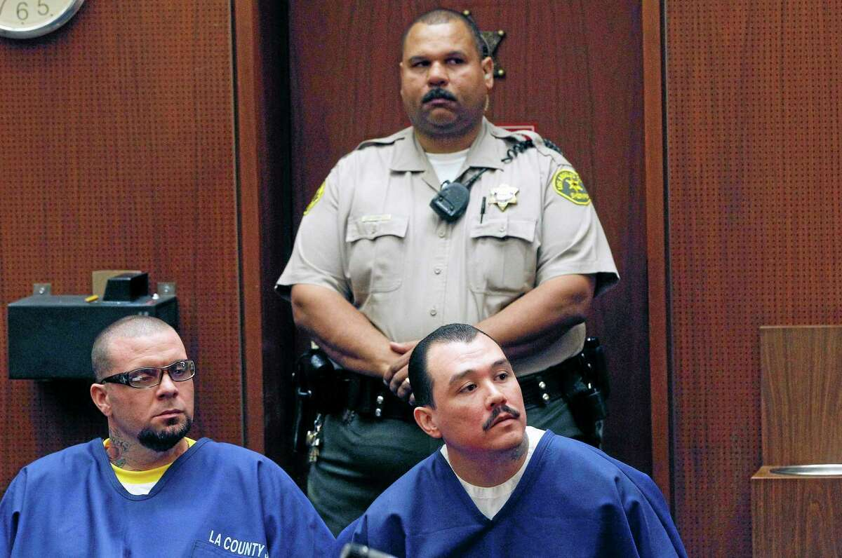 Defendants Marvin Norwood, left, and Louie Sanchez appear during a hearing Thursday Feb. 20, 2014 in Los Angeles. The two men pleaded guilty Thursday to a 2011 beating at Dodger Stadium that left San Francisco Giants fan Bryan Stow brain damaged and disabled. They were immediately sentenced by an angry judge who called them cowards and the sort of people that sports fans fear when they go to games.