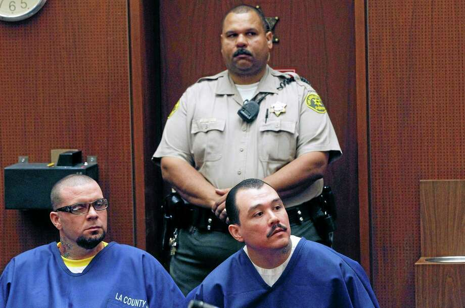 Defendants Marvin Norwood, left, and Louie Sanchez appear during a hearing Thursday Feb. 20, 2014 in Los Angeles. The two men pleaded guilty Thursday to a 2011 beating at Dodger Stadium that left San Francisco Giants fan Bryan Stow brain damaged and disabled. They were immediately sentenced by an angry judge who called them cowards and the sort of people that sports fans fear when they go to games. Photo: AP Photo/Nick Ut  / AP