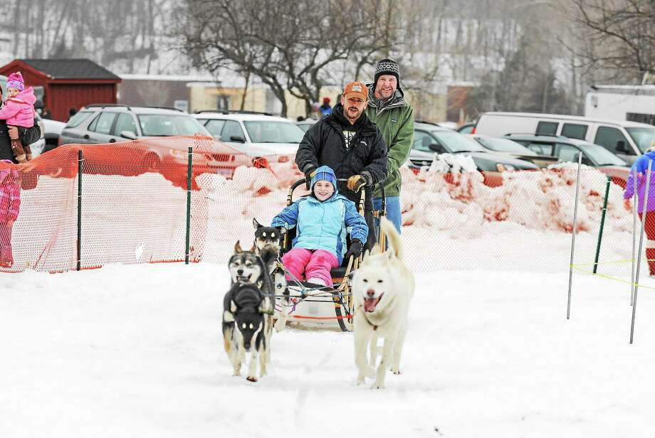Guests enjoy the dog sleigh ride at last year's Lyman Orchards' Winter Fest in Middlefield. The seasonal event returns this weekend. Photo: Photo Courtesy Of Lyman Orchards