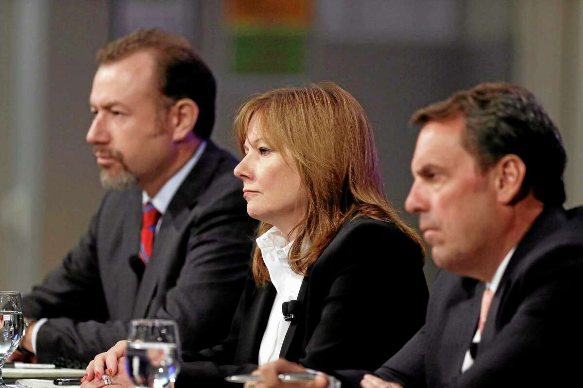 From left, General Motors President Dan Ammann, CEO Mary Barra and Executive Vice President Mark Reuss hold a news conference Thursday in Michigan.