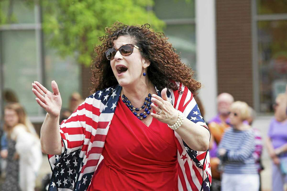 Republican Common Councilwoman Sandra Russo-Driska, who's tossed her hat in the ring to run against two-term Democratic Mayor Dan Drew, marches in Middletown's Memorial Day parade wearing the red, white and blue.