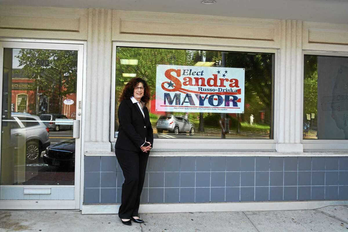 Sandra Russo-Driska, who is seeking the Republican party's endorsement to run against Middletown's two-term Mayor Dan Drew, stands outside of her campaign headquarters on Main Street.