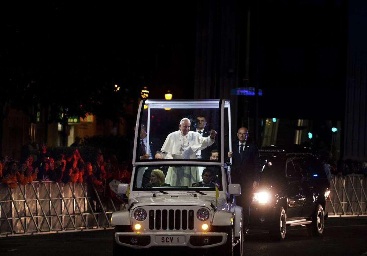Pope Francis waves to the crowd from the popemobile during a parade in Philadelphia on Sept. 27.