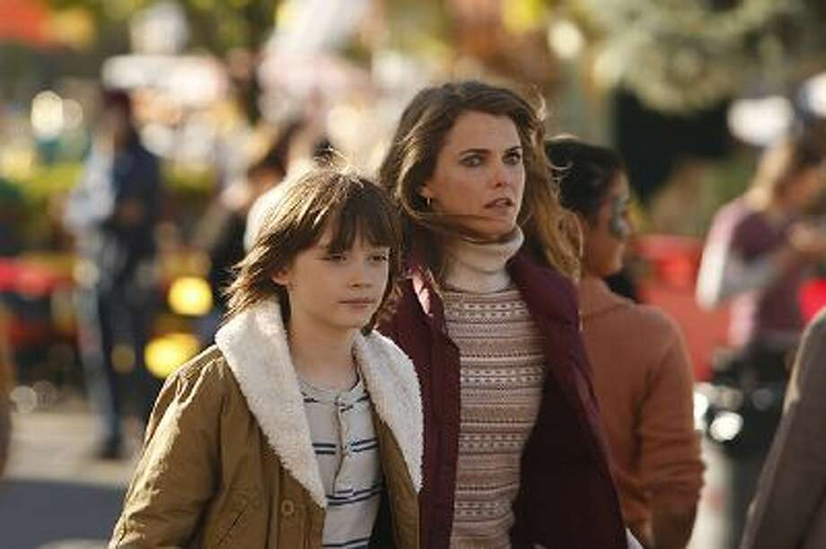 "Keidrich Sellati, left, as Henry Jennings, and Keri Russell as Elizabeth Jennings in FX's""The Americans."" Russell plays a Soviet spy living in the Washington area whose children think she works at a travel agency. Saturday advance. Illustrates TV-AMERICANS-ADV22 (category e), by Jessica Goldstein, special to The Washington Post.  Moved Thursday, February 20, 2014. (MUST CREDIT: Craig Blankenhorn/FX.) Photo: THE WASHINGTON POST / THE WASHINGTON POST"