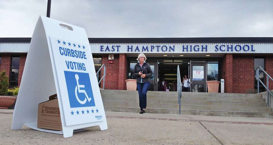 Middle Haddam resident Sue Hamm exits East Hampton High School where voters cast their ballot during 2014-15 municipal budget referendum in May. Photo: Catherine Avalone — The Middletown Press