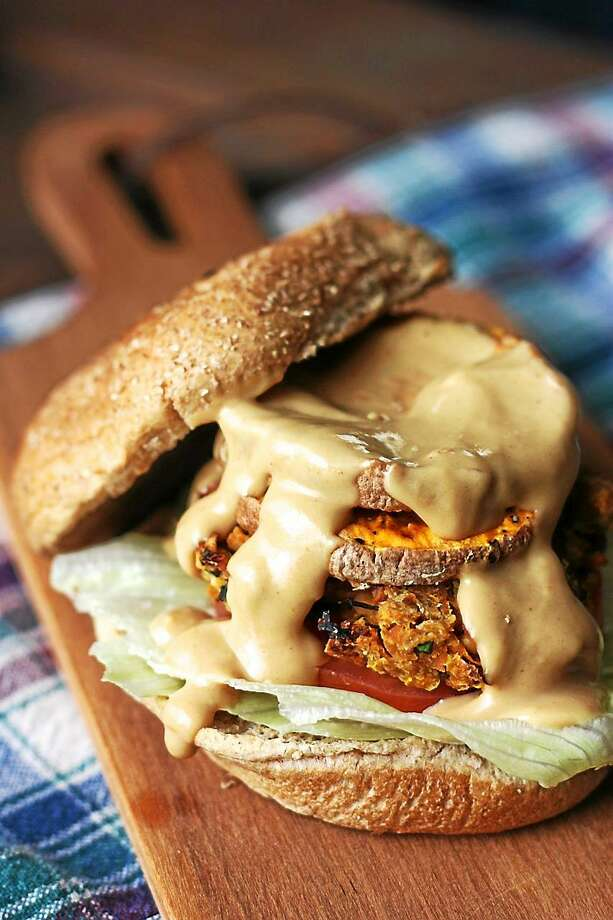 """A freshly baked whole wheat roll and a drizzle of lemon tahini dressing make Sweet Potato Burgers the perfect entree for Valentine's Day. I.O.N. Restaurant at 606 Main Street in Middletown provides the """"secret"""" recipe. Photo: Courtesy I.O.N. Restaurant"""