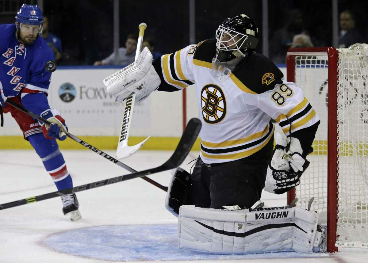 Bruins goalie Jonas Gustavsson (89) makes a save in front of Rangers left wing Rick Nash during the third period Wednesday.