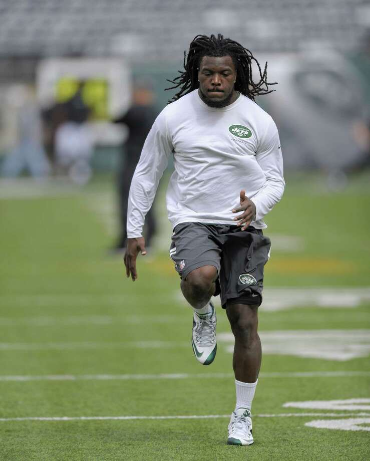 Jets running back Chris Ivory warms up before a game earlier this season. Photo: The Associated Press File Photo  / FR51951 AP