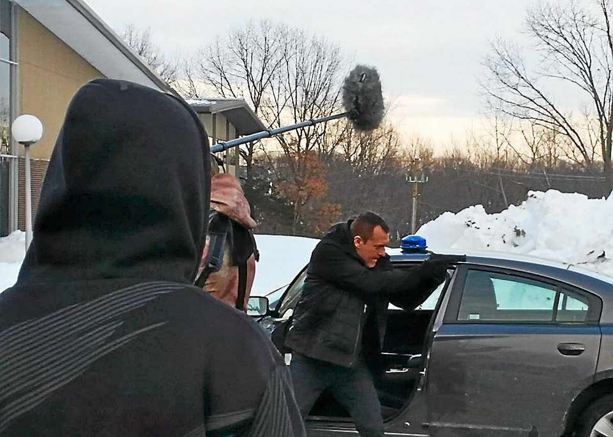 """Actor Tom Sizemore portrays Det. Broza on location in Cromwell for the feature film, """"Blue Line,"""" shooting in Cromwell, Middletown and Hartford through Feb. 13."""