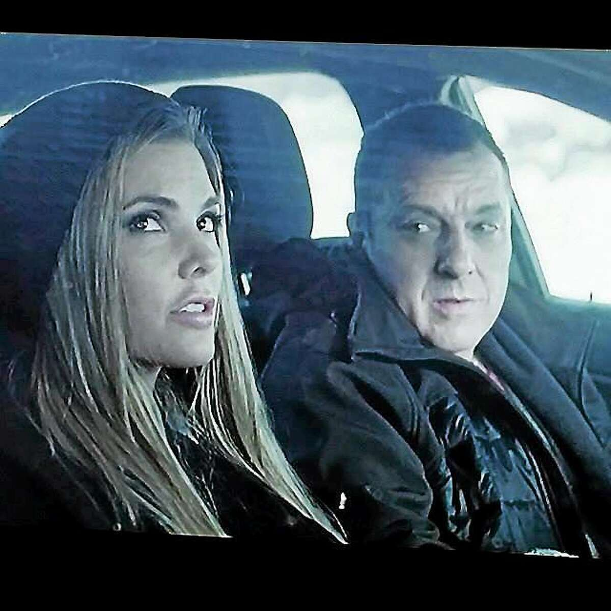 """Actor Tom Sizemore and actress Nikki Moore are shown during a scene from the feature film, """"Blue Line."""""""