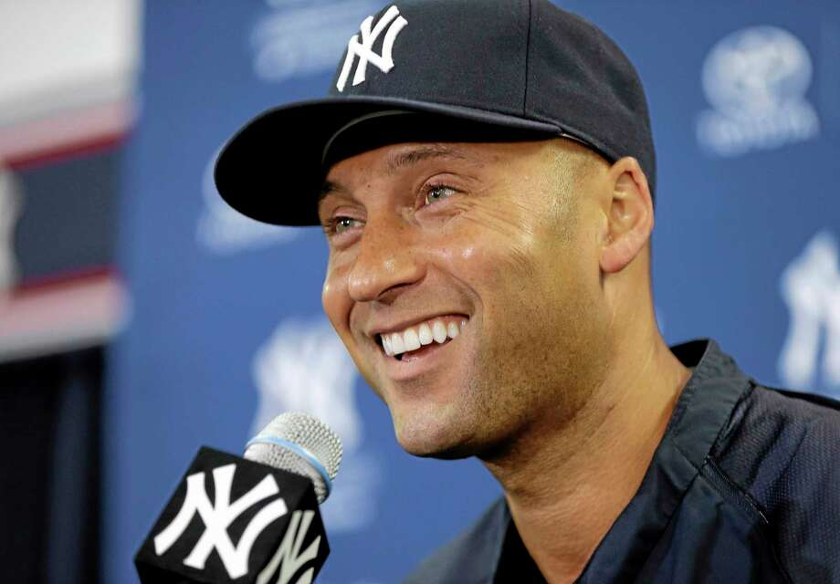 New York Yankees shortstop Derek Jeter smiles during a news conference Wednesday in Tampa, Fla. Jeter has announced he will retire at the end of the 2014 season. Photo: Chris O'Meara — The Associated Press  / AP