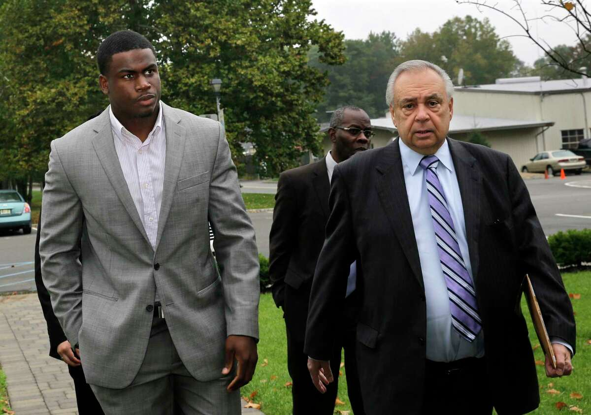 New York Jets practice squad player Quincy Enunwa, left, arrives with attorney Anthony Fusco, right, for a court appearance Wednesday in Florham Park, N.J.