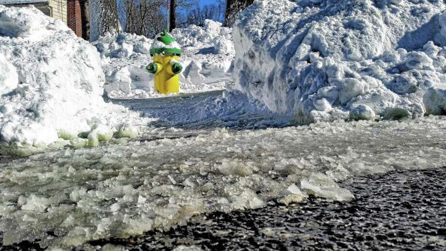 An area of three feet should be cleared around fire hydrants after each snow. Middletown fire departments rely on residents to help keep the city's 1,600 hydrants clear for use in an emergency. Photo: Kathleen Schassler — The Middletown Press