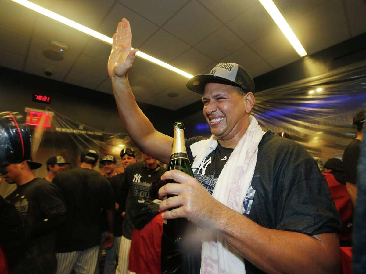 Alex Rodriguez celebrates after the Yankees clinched a wild card berth with a 4-1 victory over the Red Sox on Thursday.