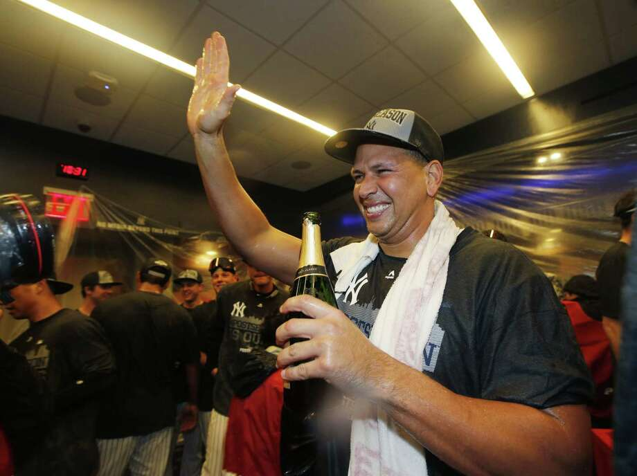 Alex Rodriguez celebrates after the Yankees clinched a wild card berth with a 4-1 victory over the Red Sox on Thursday. Photo: Kathy Willens — The Associated Press  / AP