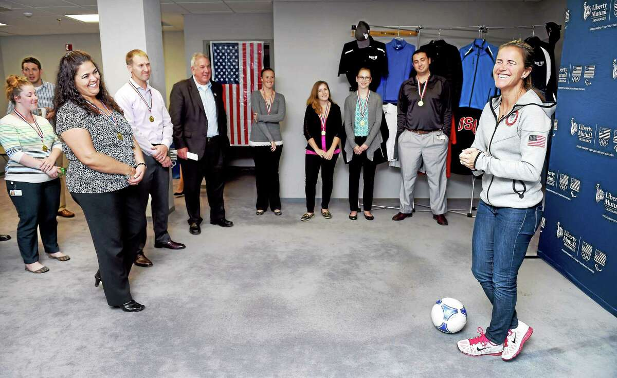 Former U.S. Olympic soccer player Brandi Chastain, right, meets with insurance claims management employees of Liberty Mutual Insurance in their Wallingford office on Wednesday.