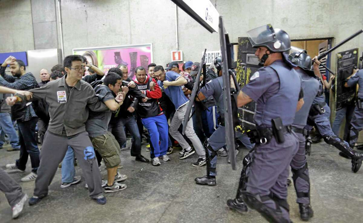 Subway train operators, along with some activists, clash with police Friday at the Ana Rosa metro station on the second day of their metro strike in Sao Paulo, Brazil.