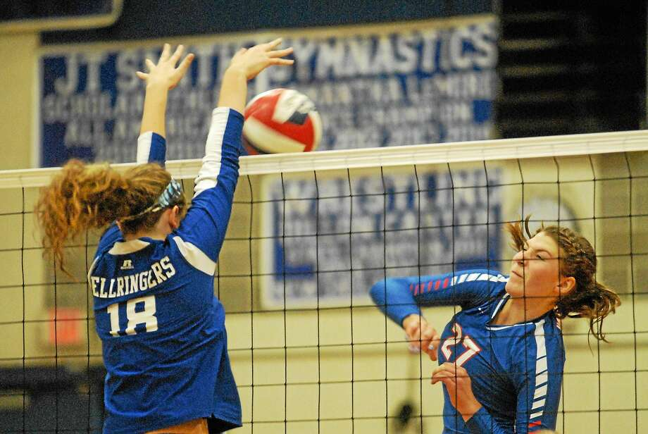 Hale-Ray junior Sage Connors tries for a kill against a block attempt from East Hampton senior Sarah Massie on Wednesday night. The Noises edged the Bellringers, 3-2, in a battle of SLC unbeatens. Photo: Jimmy Zanor -The Middletown Press