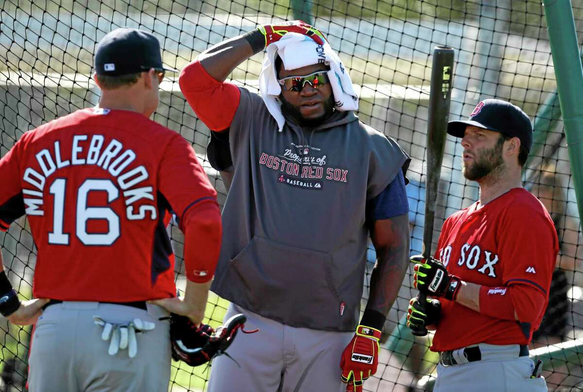 Boston Red Sox designated hitter David Ortiz, center, talks with third baseman Will Middlebrooks, left, and second baseman Dustin Pedroia during practice Tuesday in Fort Myers, Fla.